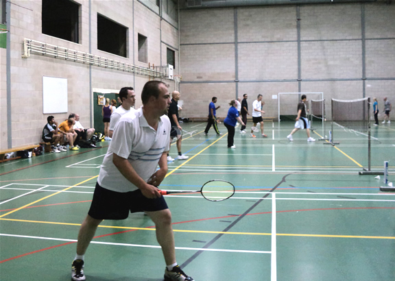 Club night at Epsom College Sports Hall; Bookham Badminton Club, Surrey, UK